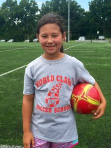 Image of Young Asian Girl with Red Soccer Ball - World Class Soccer School - Pennsylvania
