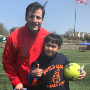 Image of Nicholas Nico Severini and a young boy camper with his thumbs up - World Class Soccer School Pennsylvania